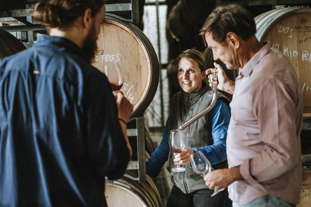 Andrew Margan & winemaking team sample wines out of barrel
